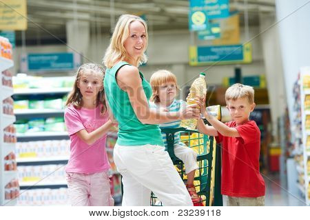 woman and boy choosing produces in grocery shopping mall