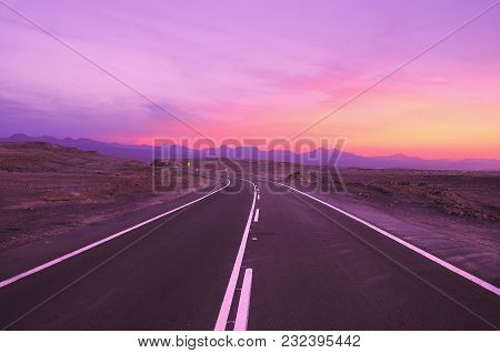 View Of The Highway At Sunset Time. Atacama Desert. Chile