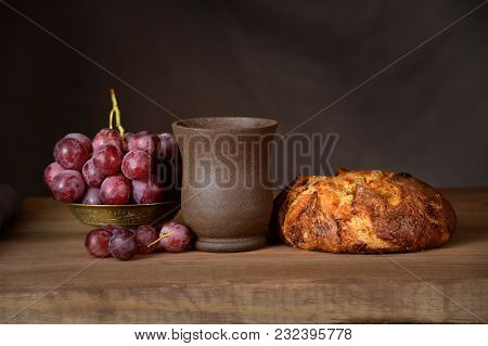Communion elements on vintage table over dark background