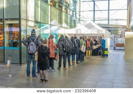 The Hague, The Netherlands - March 21, 2018: Voters Lining Up To Vote In Train Station Polling Booth