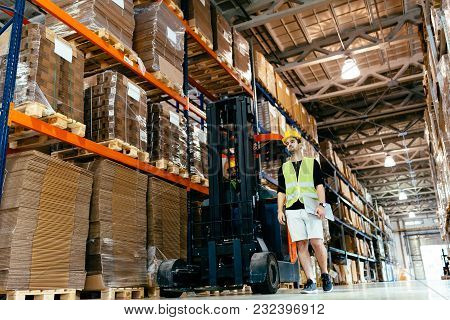 Warehouse Industry Worker Doing Logistics Work With Forklift Loader