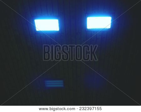 Wooden Ceiling With Lighting Panels. Fluorescent Lamps On The Modern Ceiling. Luminous Ceiling Of Sq