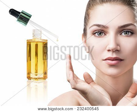 Cosmetic Oil Applying On Face Of Young Woman. Isolated On White Background.