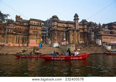 VARANASI, INDIA - MAR 21, 2018: Banks on the holy Ganges river in the early morning. According to legends, the city was founded by God Shiva about 5000 years ago.