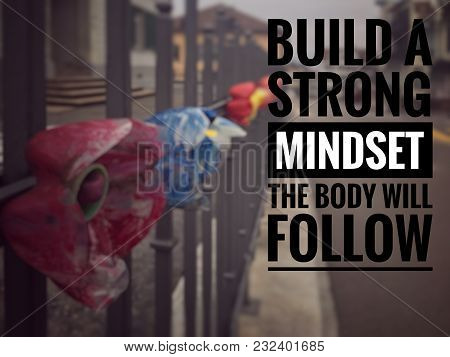 Motivational And Inspirational Quotes - Build A Strong Mindset, The Body Will Follow. With Blurred V