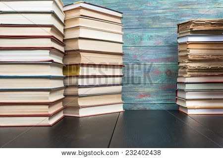 Stack Books On Wooden Background. Back To School With Copy Space.