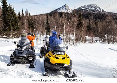Athletes Travel By Snowmobile Through The Mountains Of The South Urals And Photograph Mountains On A