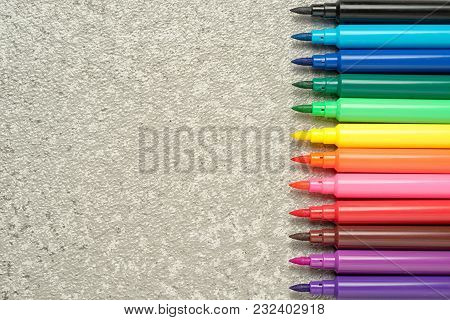 Colorful Watercolor Marker Pen Set On Silver Stone Background Top View With Copy Space.