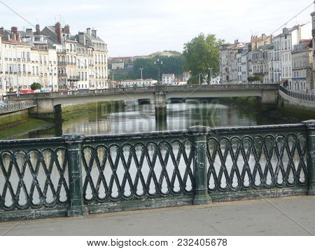 View If French Village In Pyrenees From River Bridge With Cast Iron Railings