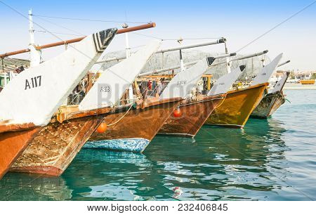 Abu Dhabi, Uae - March 27, 2005: Traditional Wooden Fishing Dhows Berthed In The Dhow Harbour In Abu