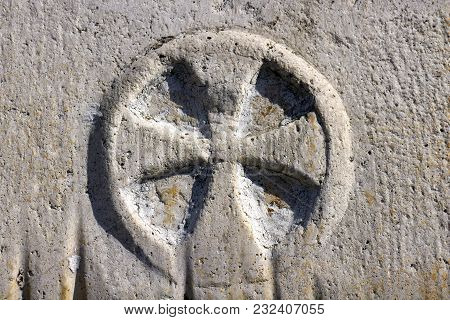 Cross In The Circle On Stone Doorpost Of Church Of St Margaret In Nerezisca On Brac Island, Croatia