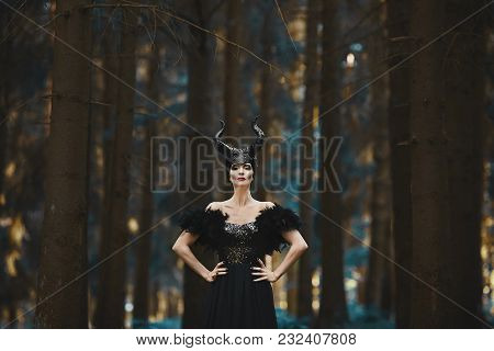 Beautiful And Fashionable Brunette Model Girl In The Image Of Maleficent - Fairytale Story.