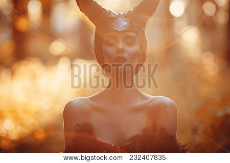 Portrait Of Beautiful And Sensual Brunette Model Girl In The Image Of Maleficent - Fairytale Story.