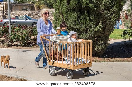 Beit Nir, Israel - March 17, 2018: Mom Walk With Childs In Old-fashioned Wooden Baby Carriage