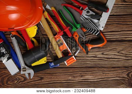 Tools on wood  background . Top view.