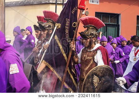 Antigua, Guatemala: March 18 2018: Three Man With Soldier Costumes Walking Through The Procession Of
