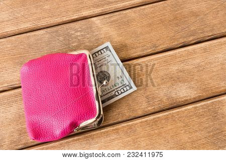 Hundred Dollar Bills In My Wallet On A Wooden Table . On Wooden Background .