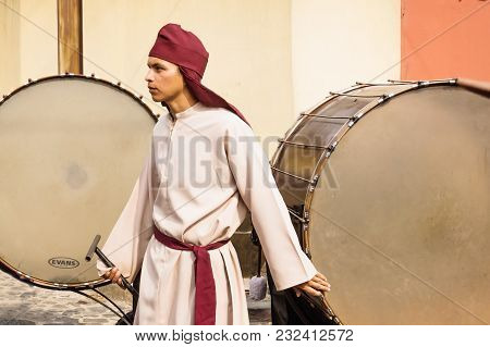 Antigua, Guatemala: March 18 2018: Man With Large Drums At The Procession Of San Bartolome De Becerr