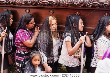 Antigua, Guatemala: March 18 2018: Women Suffering Carrying A Float At The Procession Of San Bartolo