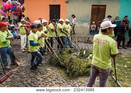 Antigua, Guatemala: March 18 2018: Cleaners With Brooms Cleaning At The Procession Of San Bartolome