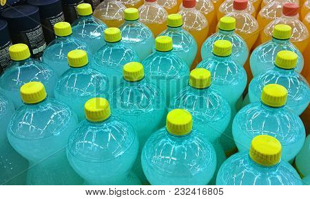 Soft Drinks Bottles Meticulously Aligned In A Supermarket