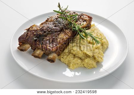White Round Plate With Baked Pork Ribs And Cornmeal Mush Isolated On White Background