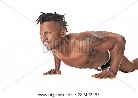 Muscular Young Man Doing Press-ups. Fit Young Man With Beautiful Torso, Isolated On White Background