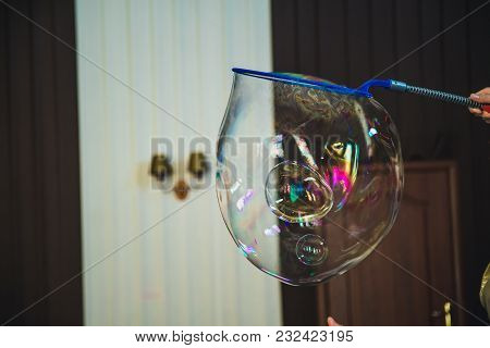 A Magician Pushing Her Hand Through The Bubble Wall