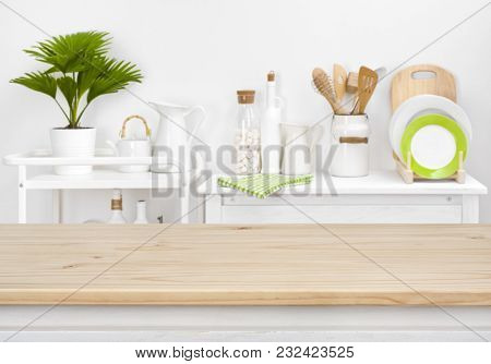 Brown Tabletop With Copyspace Over Blurred Kitchen Shelves With Utensils