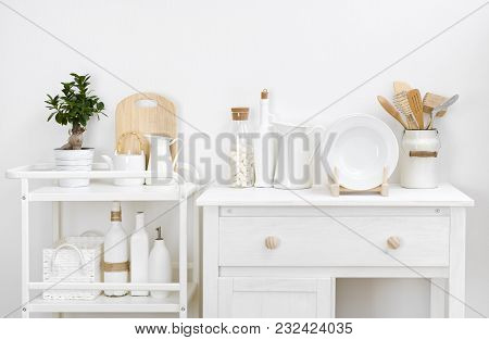Various Kitchen Utensils And Dishware With Elegant Vintage White Furniture