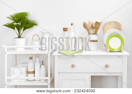 Various Kitchen Utensils And Tools With Elegant Vintage White Furniture