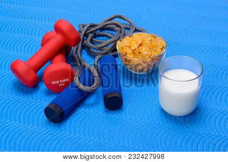 Sports Fitness Accessories On Blue Training Mat. Breakfast With Milk And Cornflakes. Frame, Healthy.