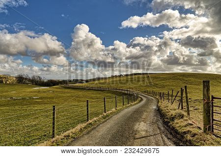 An English Country Lane, Bordered By A Barbed-wire Fence, Leading Through Farmland Near Staveley, Cu