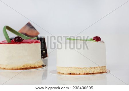 Isolated Red Cake And White Cake On The White Background