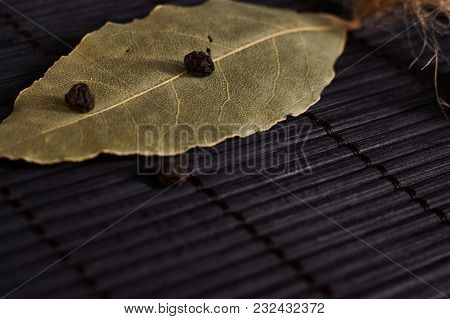 Bay Leaf On A Style Black Wooden Background