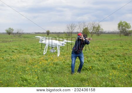 Field Next To Krasnodar, Russia - April 15, 2017: A Man Hides Himself From A Collision With A Drone.
