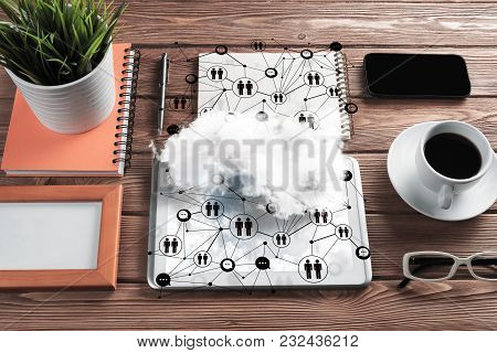 Top View Of Modern Workplace With Office Stuff, Social Network Connections And Clouds Above As Symbo