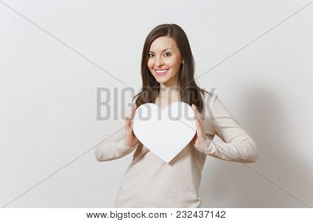 Pretty Young Cheerful Woman Holding Big White Heart In Hands Isolated On White Background. Copy Spac
