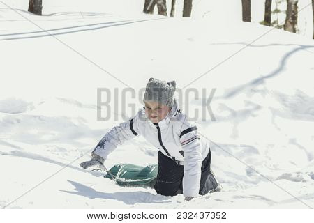 Little Girl Teenager In A Winter Sunny Forest With Sledge, Winter Family Entertainment Concept