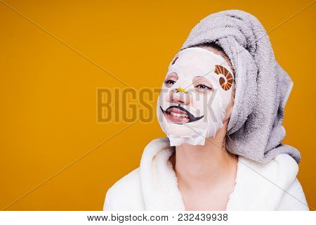 Funny Young Girl With A Towel On Her Head Smiling, On Face Mask With Dog Face