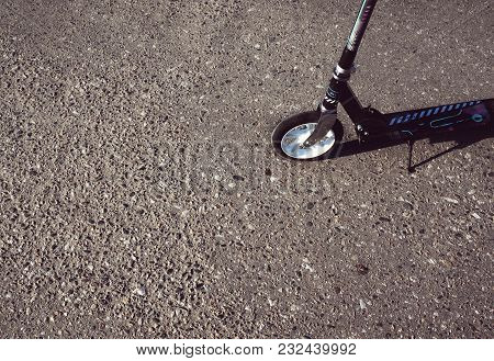 Scooter On The Gray Asphalt With Space For Text