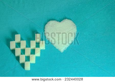 Two Hearts Made Of Sugar On A Turquoise Background Made Of Cloth