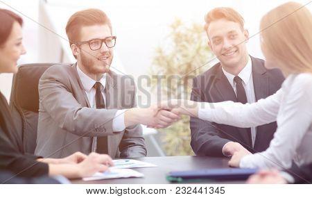 handshake of business people in office