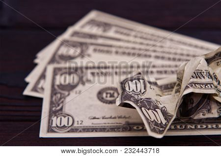 Dollar Banknotes On A Wooden Table