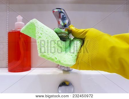 Hands In Gloves Wash The Sink In The Bathroom Cleaning