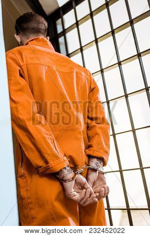 Bottom View Of Prisoner Standing In Handcuffs