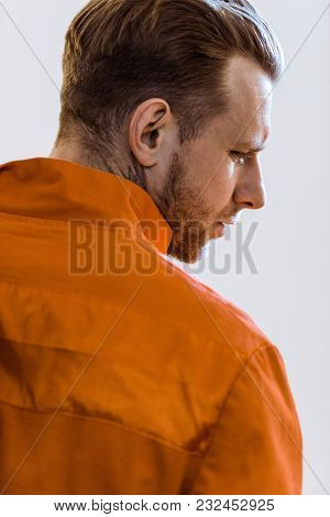 Back View Of Prisoner In Orange Uniform