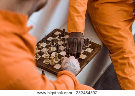 Cropped Image Of Multicultural Prisoners Playing Chess