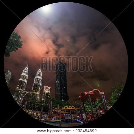 Kuala Lumpur By Night. The Most Beautiful Skyline Over The Twin Petronas Towers. View From Playgroun