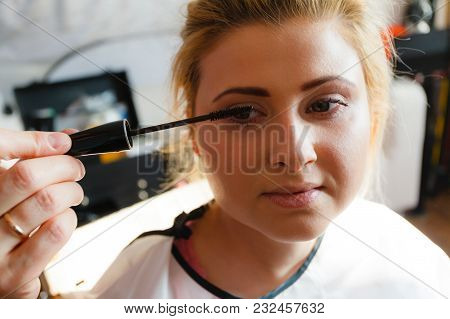 Visage, Beauty Concept. Closeup Portrait Of Woman Face Getting Her Eye Eyelashes Makeup Done By Prof